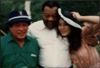 Jay McShann posing for a photo with two unidentified Japanese people