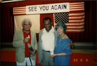 Jay McShann posing for a photo with two unidentified people