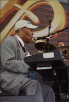 Jay McShann singing and playing an electronic piano
