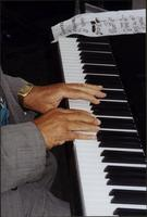 Close up of Jay McShann's hands playing piano