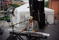 Jay McShann playing an electronic piano
