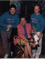 Flo Stevens seated between two radio personalities from Q104