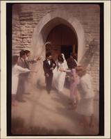 Eight Stevens models create a exiting a rock church scene of a wedding