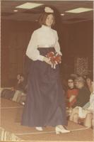 Stevens model wears a blouse and skirt during a bridal show at Glenwood Manor