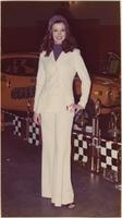 London House Model wears a white suit over a purple turtleneck during the hot rod and custom auto show