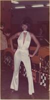 African American London House Model wears a white halter jumpsuit during the hot rod and custom auto show