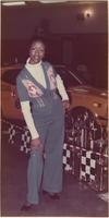 African American London House Model wears a sweater set and blue pants during the hot rod and custom auto show