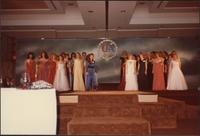 All of the Miss Kansas USA 1983 pageant contestants on stage wearing evening gowns