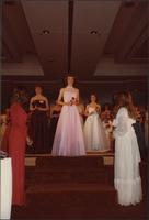Contestant 23 stands at the top of the stairs during the evening gown portion of the Miss Kansas USA 1983 pageant