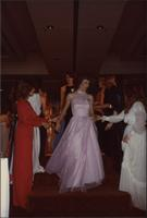Contestant 25 gets help down the stairs during the evening gown portion of the Miss Kansas USA 1983 pageant