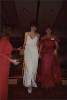 Renee Ruch gets help coming down stairs during the Miss Kansas USA 1983 pageant