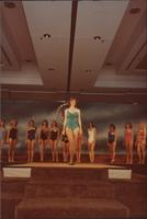 Renee Ruch, Miss Kansas USA 1983, stands center stage wearing a swimsuit during the swimsuit competition