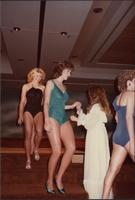 Renee Ruch, Miss Kansas USA 1983, gets help down the steps during the swimsuit competition
