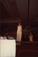 Rene Ruch walks to the front of the stage during the evening gown portion of the Miss Kansas USA 1983 pageant