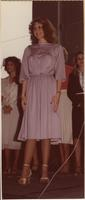contestant wearing a lavender dress stands on stage during Show-a-rama
