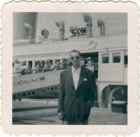 Warren Durrett standing in front of a cruise ship