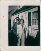 Warren Durrett and a woman in front of a house