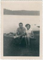 Warren Durrett sitting with a woman on the edge of a small boat
