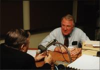 Walt Bodine and Edwin Meese speak off air in the studio during an episode of The Walt Bodine Show on KCUR