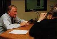 Walt Bodine (right) and Edwin Meese (left) speak off air in the studio during an episode of The Walt Bodine Show on KCUR