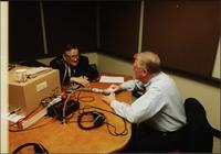 Walt Bodine (left) and Edwin Meese (right) speak off air in the studio during an episode of The Walt Bodine Show on KCUR