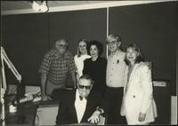 Walt Bodine, Executive Producer Andrea Young, and staff pose for the camera in the studio during Bodine's time as host of The Walt Bodine Show at KCUR