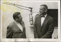 Walt Bodine interviews an unidentified man on air in the studio