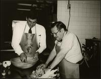 Wendell Anchutz and Walt Bodine cook