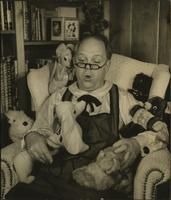 Ted Malone talks with stuffed animals
