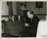 Ted Malone broadcasts from the kitchen of the Edgar Allan Poe Cottage