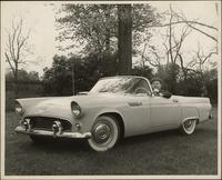 Ted Malone sits in a Thunderbird convertible sedan