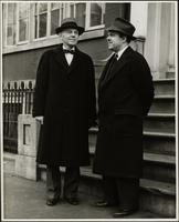 Ted Malone stands with the headmaster of the Staten Island Academy, Stephen J. Botsford in front of the House of Genius
