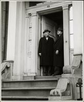 Ted Malone stands with the headmaster of the Staten Island Academy, Stephen J. Botsford in the doorway of the House of Genius