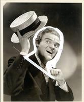 Spike Jones waving a hat
