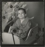 Boy by a Christmas tree
