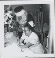 Santa visiting a young child in his hospital bed