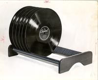 Record rack holding six Capitol 78-rpm records