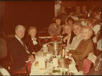 Martha Jane Starr with John W. Starr, and others seated at a table in a restaurant