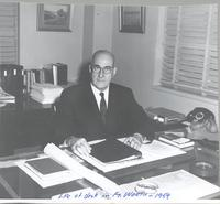 L. Perry Cookingham at desk