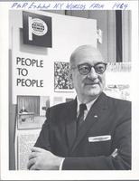 L. Perry Cookingham standing in front of People to People Exhibit