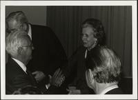 Miller Nichols shaking Martha Jane Starr's hand at KC Mace Conference award ceremony