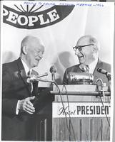 L. Perry Cookingham and Dwight Eisenhower at podium