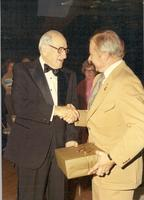 Cookingham shaking hands with mayor Charles Wheeler
