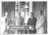 LPC poses with sign for Cookingham Drive