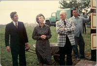 Richard Berkley, Anita Gorman, and L. Perry Cookingham stand in front of wheel barrow