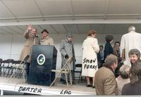Jerry Darter, L. Perry Cookingham, Susan Perry, Anita Gorman, and unidentified persons stand on stage