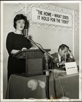 "Mrs. John H. Kreamer at podium of panel forum: ""The home - What does it hold for the teen?"" at the KC Mace Conference, 1967"