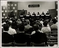 "Porter Hall at podium of panel forum on ""Family standards and parental controls"" at the KC Mace Conference, 1967"