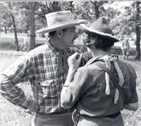 L. Perry Cookingham in Western wear with woman standing in front of him