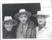 L. Perry Cookingham stands next to two other unidentified men all wear cowboy hats